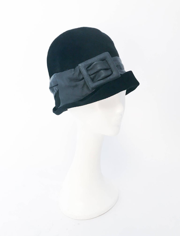 1960s Mr. John Black Cashmere Felt Hat with Leather Band. Black cashmere felt hat with black leather band and buckle.