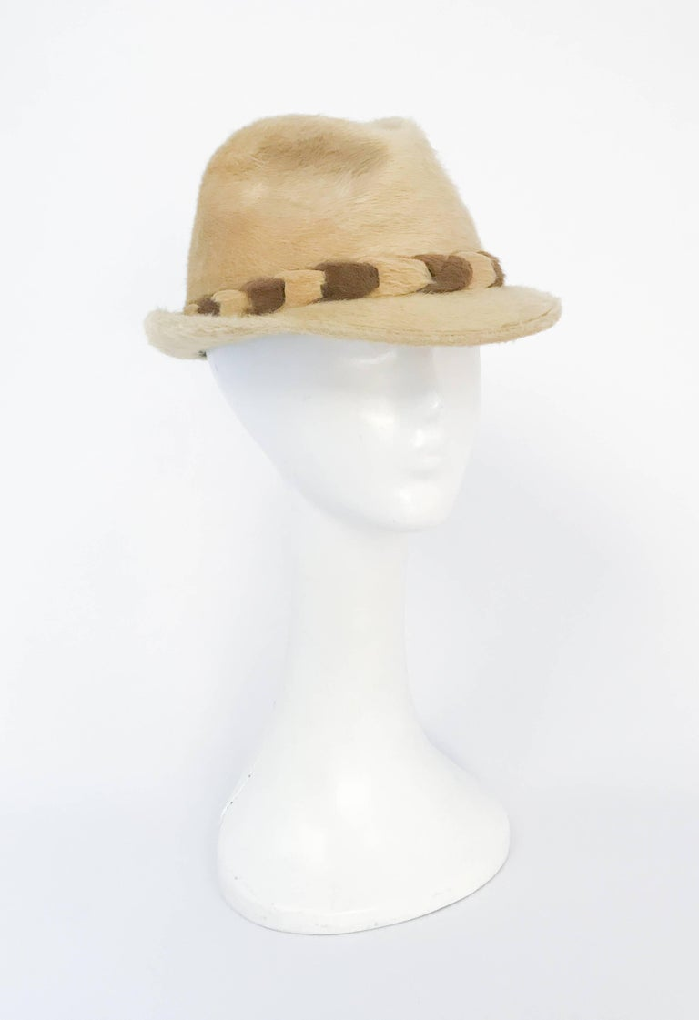 1960s Tan Beaver Felt hat with Two-Tone Band. Tan beaver felt hat with two-toned linked band. Feather accent on the side. Size 22 1/2 womens. Size 7 1/8 Mens.