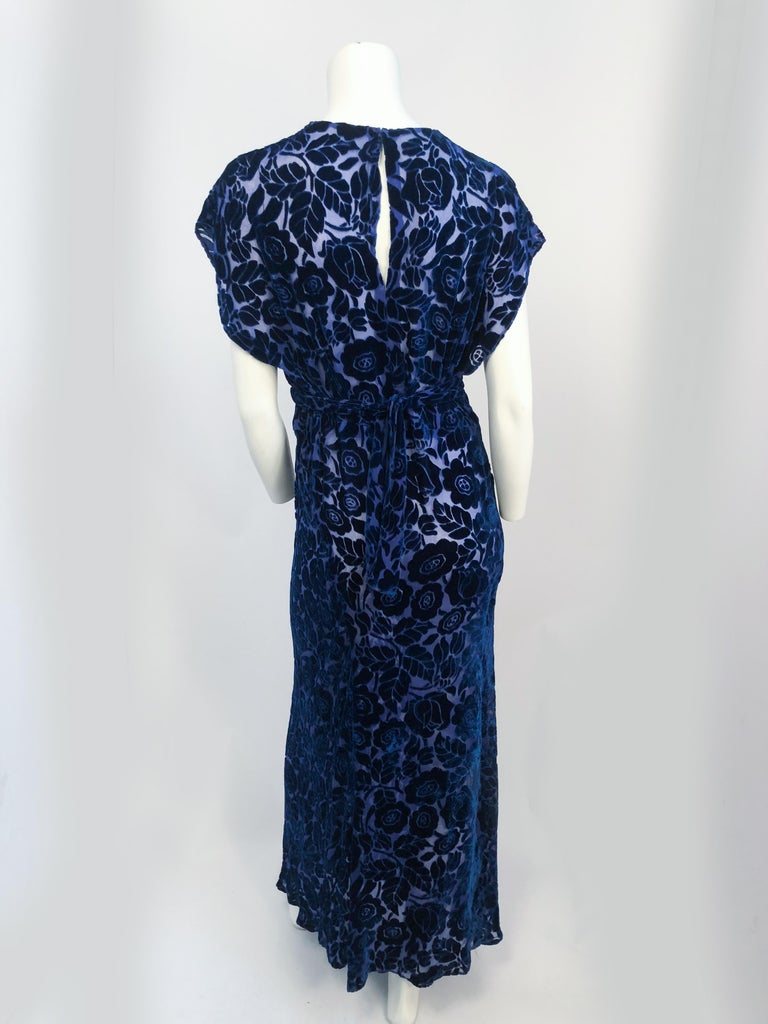 1930s Royal Blue Art Deco Cut Velvet Gown. Royal blue cut velvet gown with an art deco pattern. Sash around waist that ties at the back.