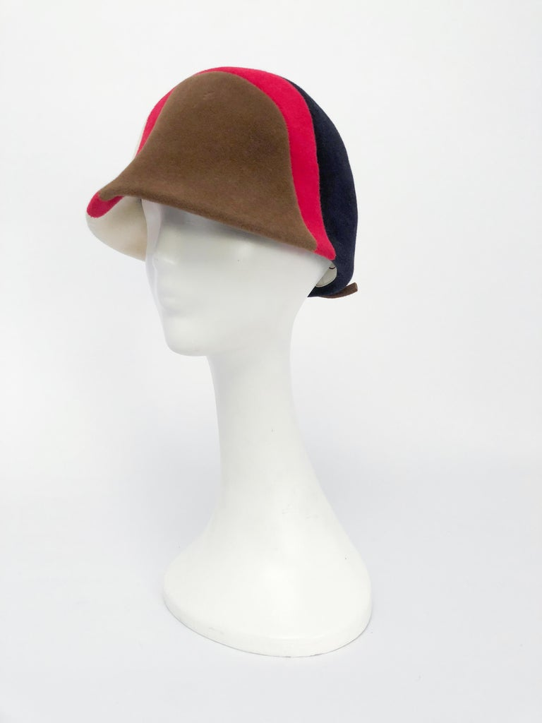 1960s Caroline Mod Hat With Geometric Pattern. Mod hat with Navy, raspberry, cream, and taupe color wave.
