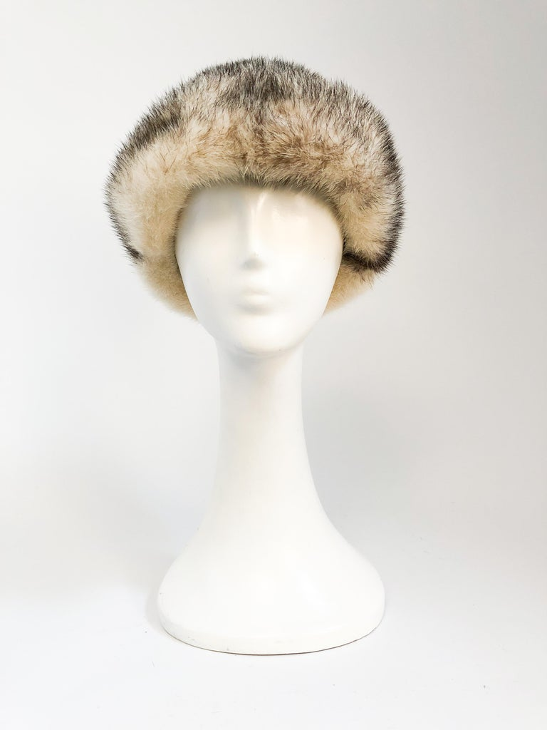 1960s Mink I. Magnin Hat. Cream and brown mink hat with rolled brim and woven inner band. Original I. Magnin department store tag attached