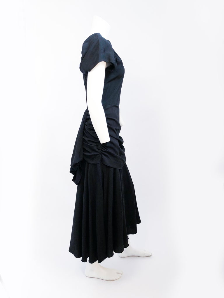 Women's 1980's Black Rouched Dress with Double Flounces on the Back For Sale