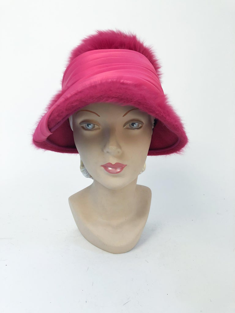 1960s Hot Pink/ fuchsia Angora cloche with pleated satin hat band that is set asymmetrically on the brim of the hat.
