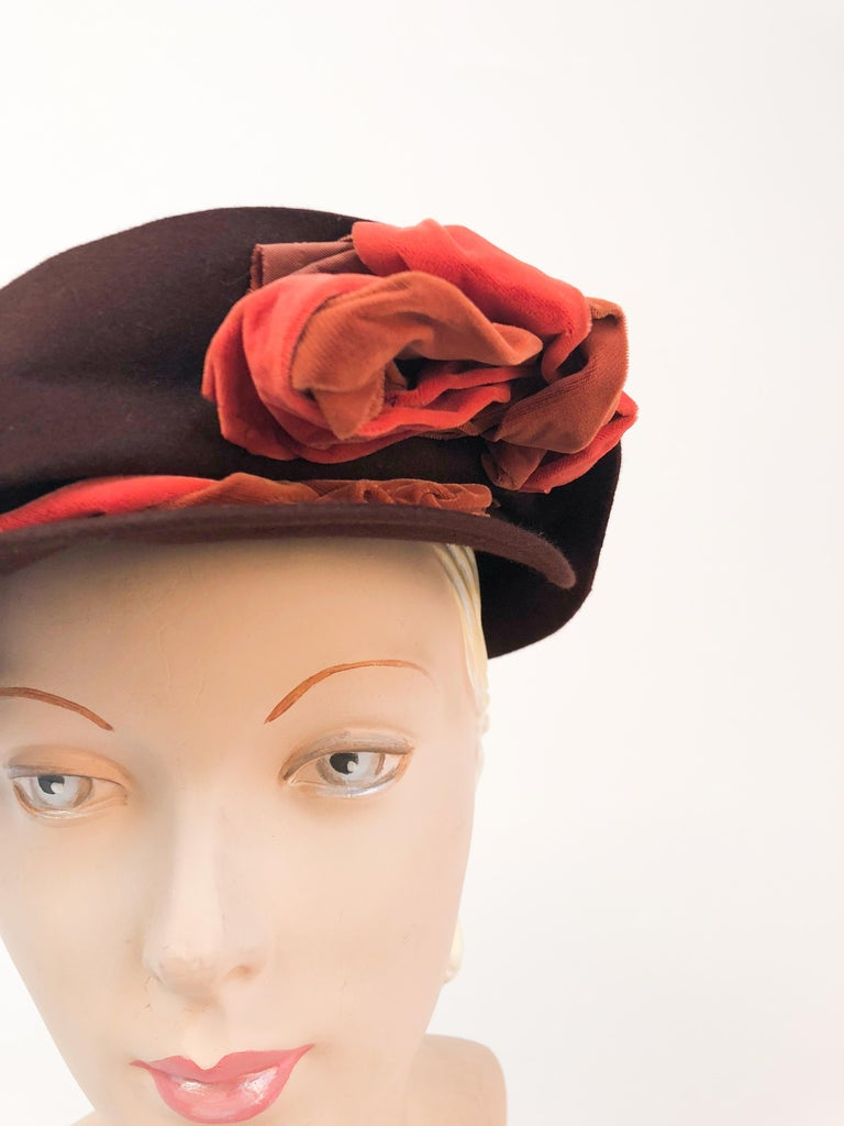 1930s Brown Fur Felt Hat with Multi toned Cotton Velvet Twisted Accent. Chocolate brown beaver fur felt hat with orange and rust hand twisted decorated asymmetrical brim.