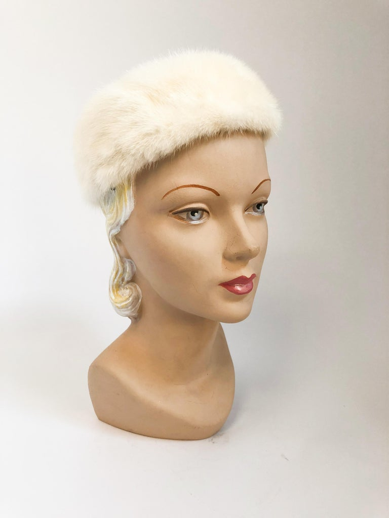 1960s I. Magnin white mink fur hat with satin lining and hair clips on the interior sides.
