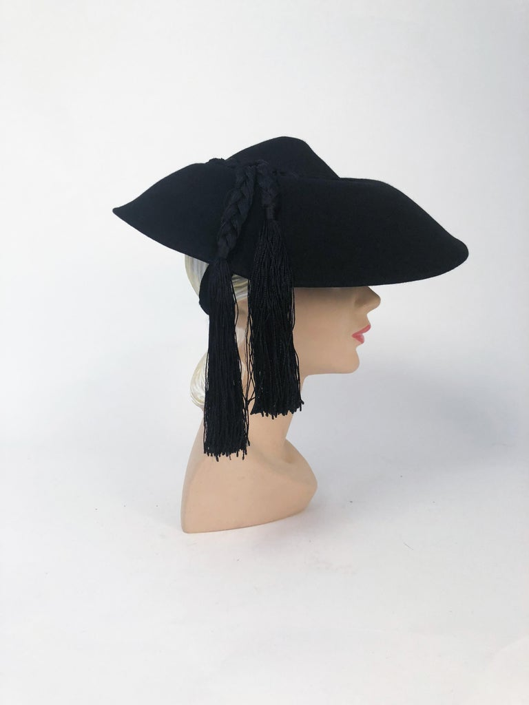 1940s Black Fur Felt Wide-Brimmed Hat With Silk Cord Tassels. Black Fur felt wide-brimmed hat with braided silk cord decorative band and tassels with felt keepers and structure.