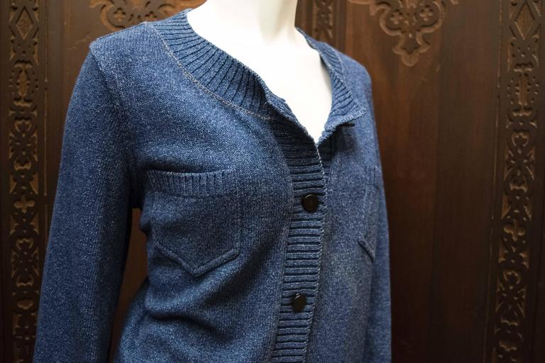 90s Chanel Blue Knit Cardigan   Sublime Chanel cardigan, from the Winter collection and is a fantastic staple item for fall. Measuring  B 38 W 38 L 23