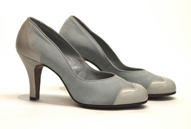 """1950s pale blue suede spectator heels.   Measurements: Insole (toe to heel): 9 1/2"""" Palm of the footbed: 3"""" Heel Hight: 3"""""""