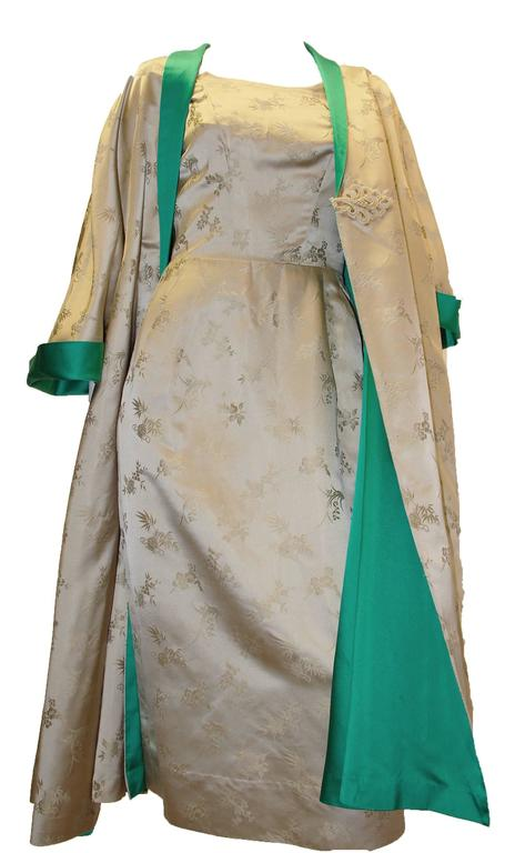 1950s silk two piece chinoiserie evening set. Swing coat and dress both have front pockets! Metal zipper closure on dress. Frog closure on jacket.    Measurements: Dress (fitted, silk fabric has no give)  Bust: 32
