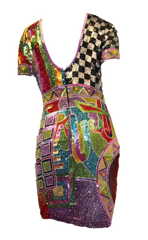 80s multi colored heavily beaded and sequined Naeem Khan cocktail dress. Fully lined. Zips up the back