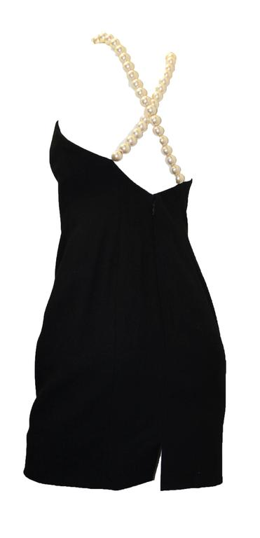 """1990s Searavelli mini dress with large pearl strand straps. Zips up back. 100% wool.   Measurements: Bust: 38"""" Waist: 28"""" Hips: 36"""" Back kick slit: 3 1/2"""""""