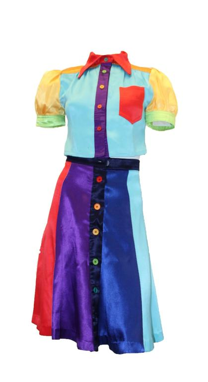 1970s Mr. Freedom mod rainbow two-piece. Buttons up front of blouse and skirt
