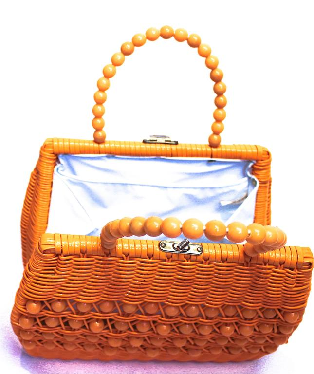 """60's woven basket purse.  Measures:  9"""" in height 11"""" wide 4"""" deep  Handles are 13"""" long"""