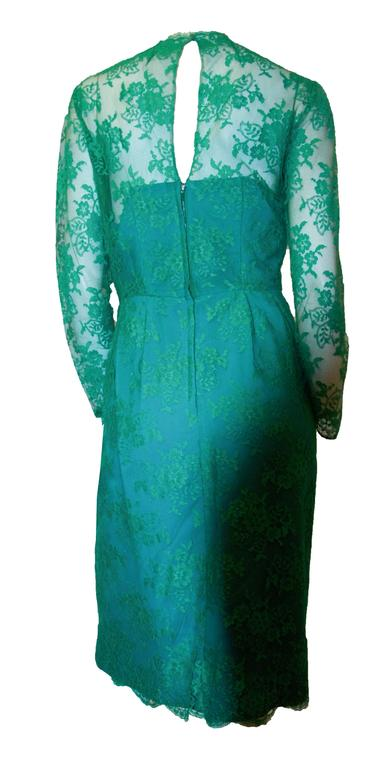 60s green lace illusion cocktail dress with long sleeves. Metal zipper.