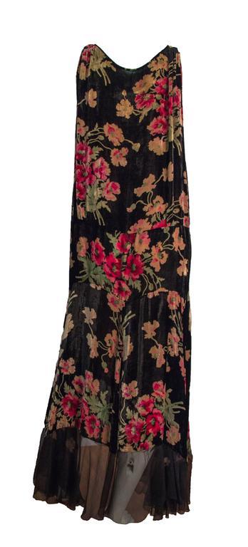 20s velvet floral printed drop waist dress with beaded embellishment along bust line. Chiffon trim along hemline. Unlined