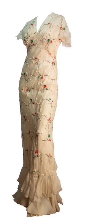 30s cream colored bias cut sheer silk dress with ruffle hem, trim and flutter sleeves. Floral embroidery. Original bias cut slip.