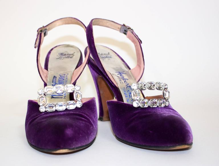 50s purple velvet slingback heels with rhinestone adornments. Leather soles 