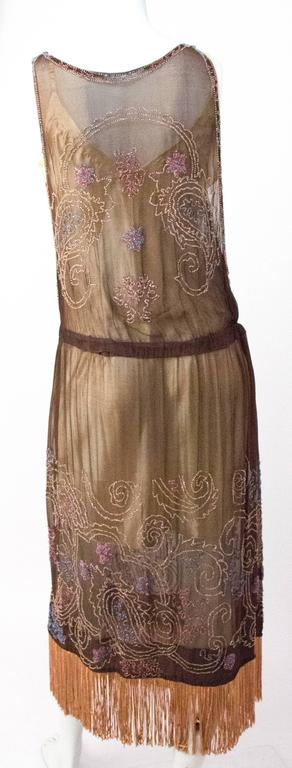 20s Brown Chiffon Dress with Peach Beading & Fringe. Elastic in waist. Unlined.