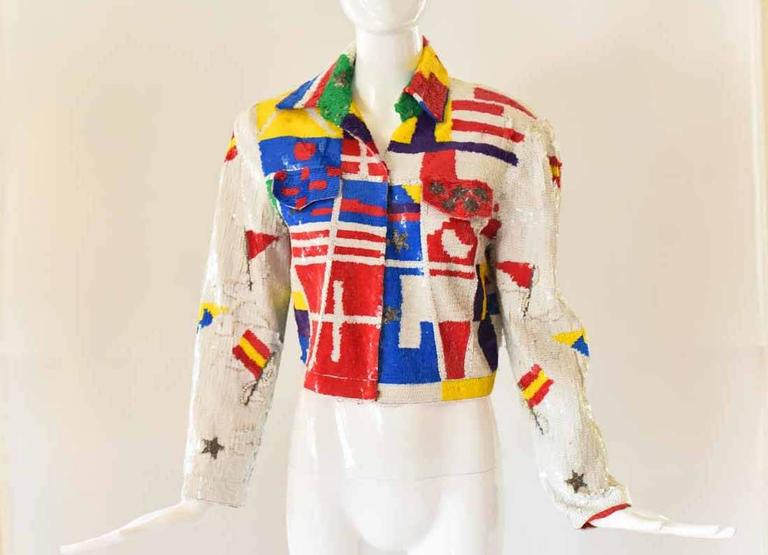 This fabulous vintage 1980s Lillie Rubin jacket features all-over sequins in an eclectic and colorful print. With stars, stripes, and pearl accents, this jacket would look great layered over a simple tee, chambray top, or a knit dress. The