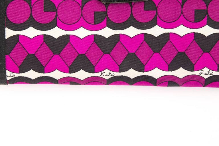 Funky Finders has this circa 1970's clutch wallet from the house of Emilio Pucci. it features a superb, signed  geometric motif coupled with brass 'EP' logo on the closure. silk blend print complimented with leather trim & interior. signed Emilio
