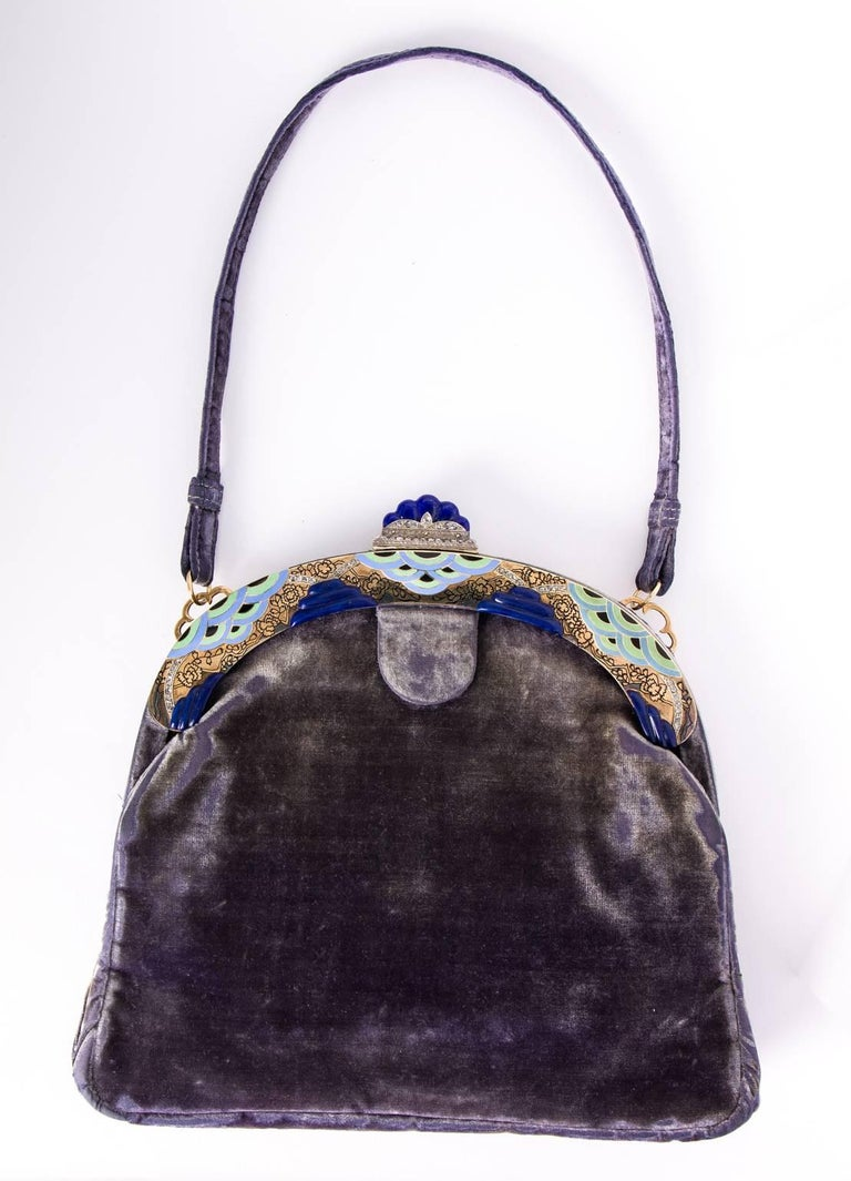 Ca. 1920's French Art Deco purple velvet evening bag. 14K gold frame embellished with diamonds, carved lapis lazuli clasp and enameled edges in a stylized oriental cloud motif. Very rare piece.