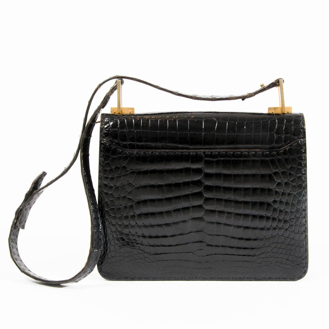 Off-White™ is well-known for its accessories; in particular, those Binder Clip bags that have found their way onto the arms of it girls worldwide. Now, Virgil Abloh's brand is back with a patent croc-embossed bag that's equal parts edgy and elegant. What the mini bag lacks in size, it more than makes up for in street-cred. The main compartment boasts a zipped pocket as well as hidden.