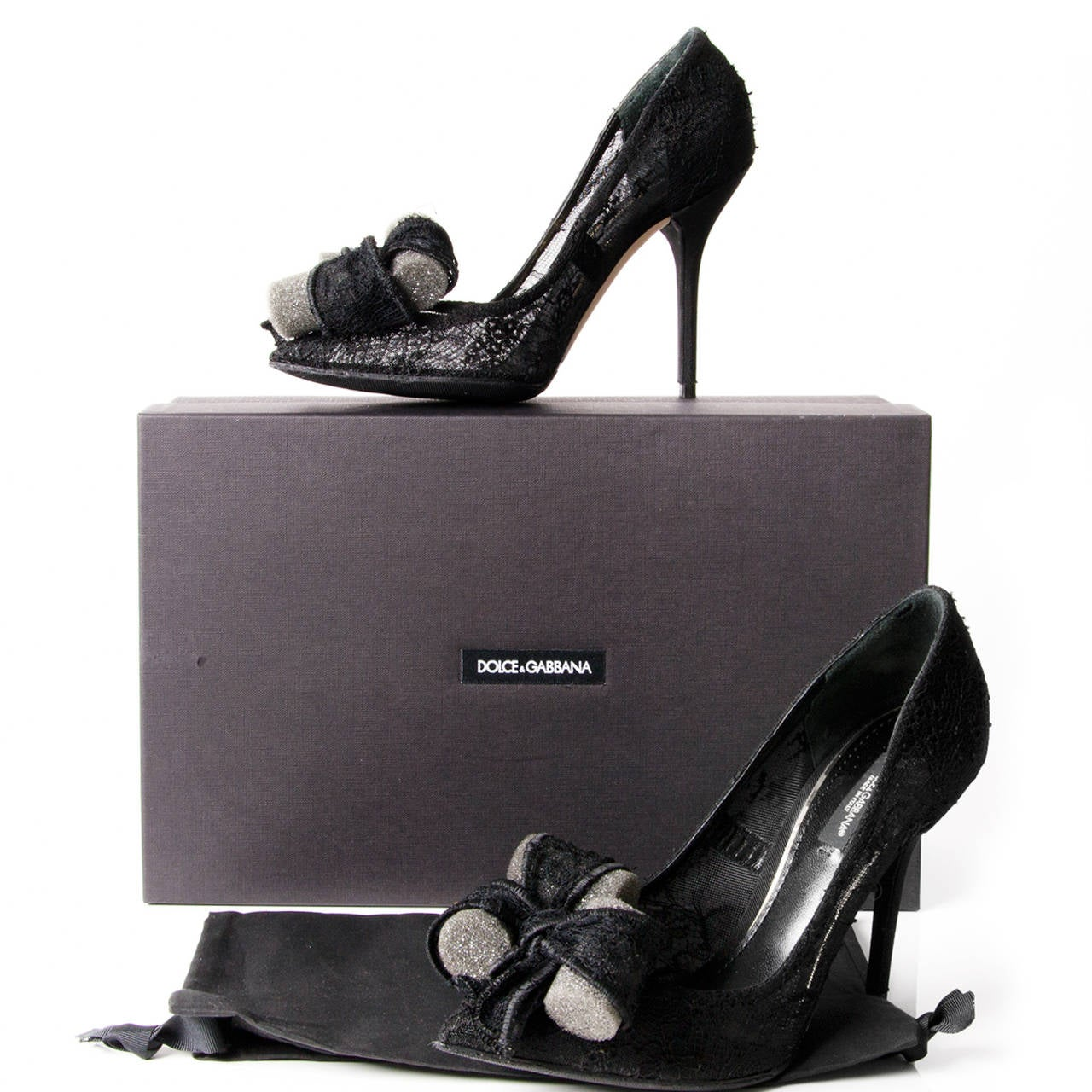 Dolce & Gabbana cotton lace covered high heel. Chantilly lace bow with internal iron wiring. Leather innersole. Stiletto heel.