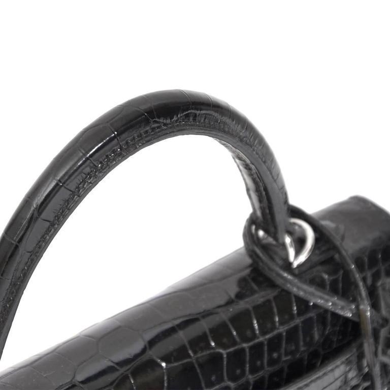d5241cc3c8f8 RARE Brand New Black Kelly Crocodile Porosus 25 PHW For Sale. Super rare!  This is a 25cm Black Crocodile Porosus Hermes Birkin bag. The bag