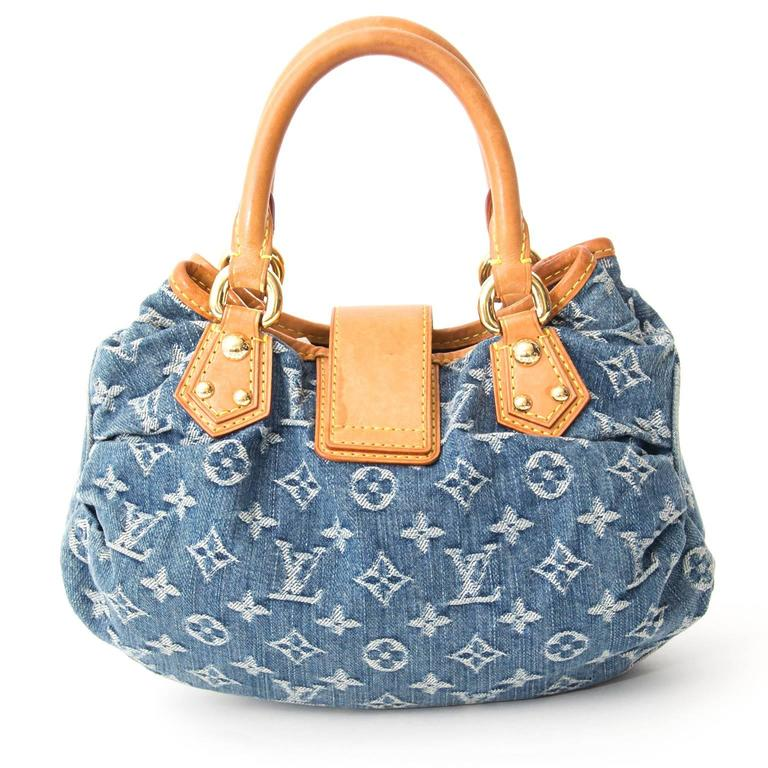 Louis Vuitton Mini Denim Monogram Bag.  Bag with a golden buckle and yellow suede lining.  Go for a casual denim look with this cute little bag.