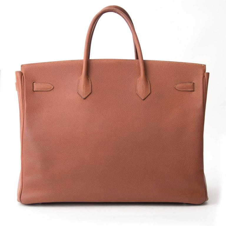 Hermes Birkin Marron Veau Fjord.  Fjord leather, is known for its fair softness and matte texture and has a high water resistance. The Hermes Birkin is now the symbol of class and fashion. Its highly recognizable design makes it a staple of the