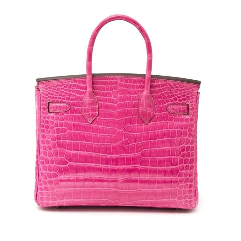 THIS RARE BIRKIN WILL TAKE YOUR BREATH AWAY! One of the most beautiful colors. Shiny Fuchsia Porosus with silver hardware . The Birkin is one of the most sought after especially in this vibrant fuchsia Porosus.   Comes with the original box, receipt