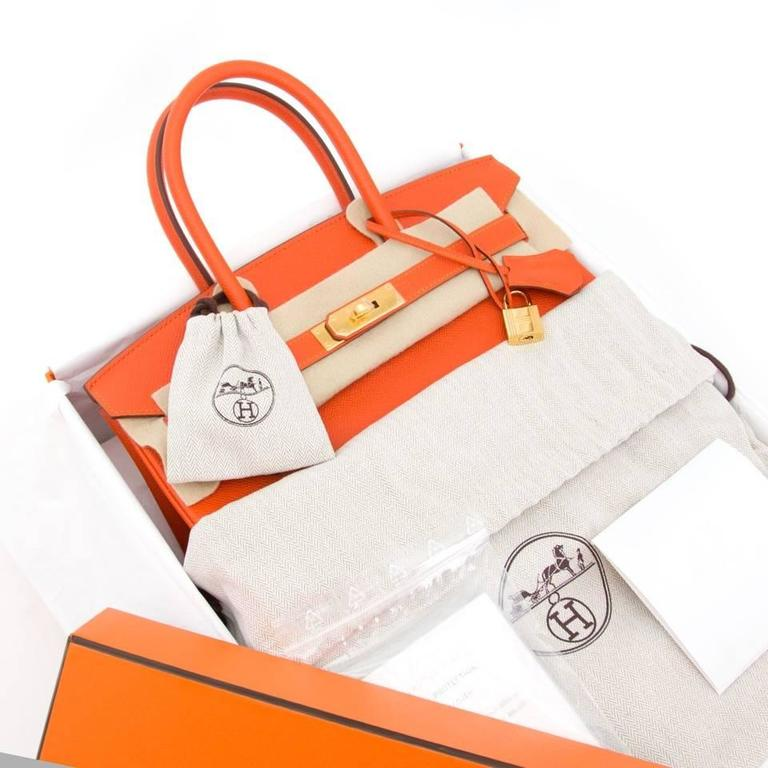 Hermes Birkin 30 Feu Epsom Brand new, recently storebought Hermès Birkin bag measuring 30cm. The gold-tone hardware emphasizes the youtfull and feminine Orange Feu. This compressed type of leather holds true to its shape in all instances and is