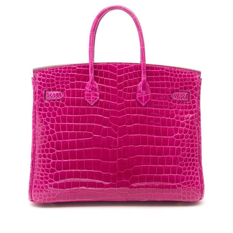 This Rare Hermes Birkin 35cm Rose Sheherazade Porosus Lisse  bag is accentuated with palladium hardware and comes with all of the original accessories.   This limited Birkin bag is made from porosus crocodile skin with a brillant shine, which is
