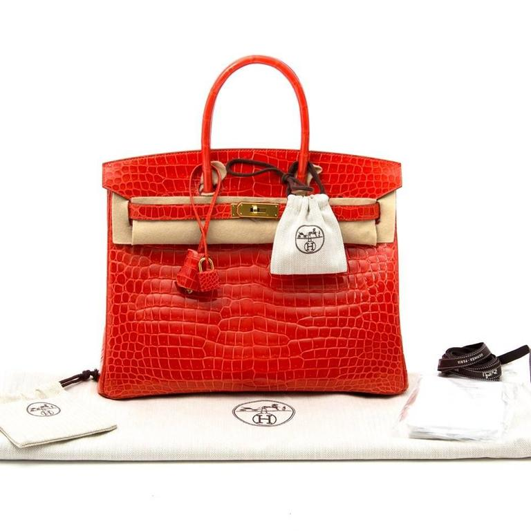 b811a6ad55af ... purchase very rare hermes orange poppy porosus crocodile birkin 35.  this limited birkin bag is