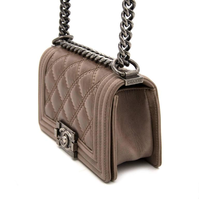 The Chanel Boy bag is one of Chanel s most sought-after bags. This taupe 27e9c9ca6757
