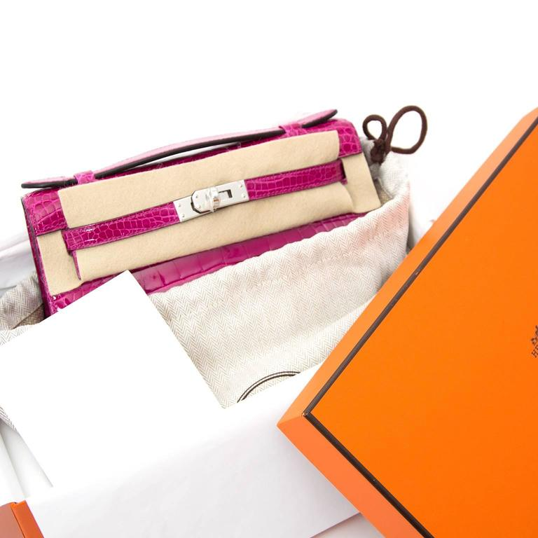 Rare brand new Hermes Kelly Pochette Rose SheheRazade Croco Alligator . Searching for an iconic Kelly in a clutch version? Meet this exquisite Hermès Kelly Cut Pochette. This perfect day and night piece is made out of crcoo alligator  accentuated