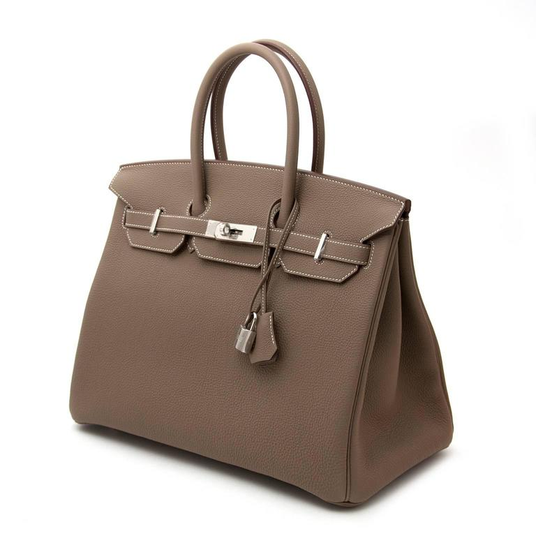 Hermès Birkin 35 Etoupe Togo  Skip the waiting list and become the owner of the most iconic and sought-after bag.  The beautiful palladium hardware compliments the etoupe color, making this a gorgeous stylish bag.  Comes with full set.