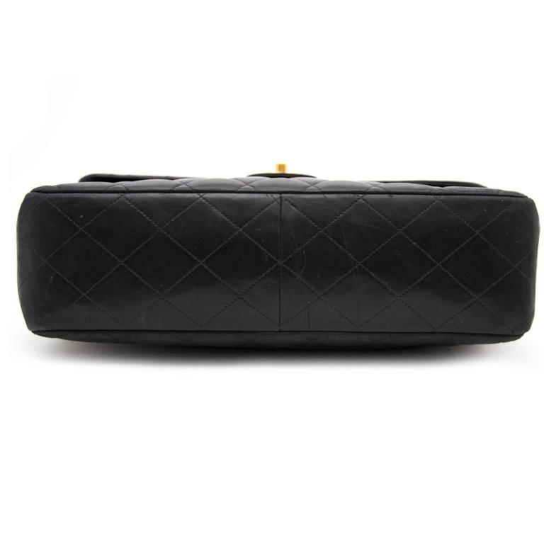 Very Good Vintage Condition    Vintage Chanel Black Lamskin Jumbo Flap Bag  This iconic bag is considered to be one of the most classically bags to wear today.  This black jumbo classic single flap bag is crafted in black caviar diamond quilted