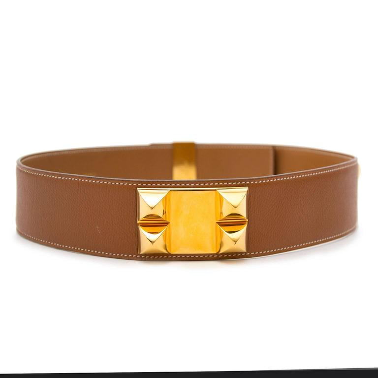Hermes Brown Collier De Chien Belt  This timeless CDC Hermes belt is definitely a musthave for every Hermes lover. The beautiful brown Epsom leather and white contrast stitching match perfectly. The belt is finished with the classic gold rhodium