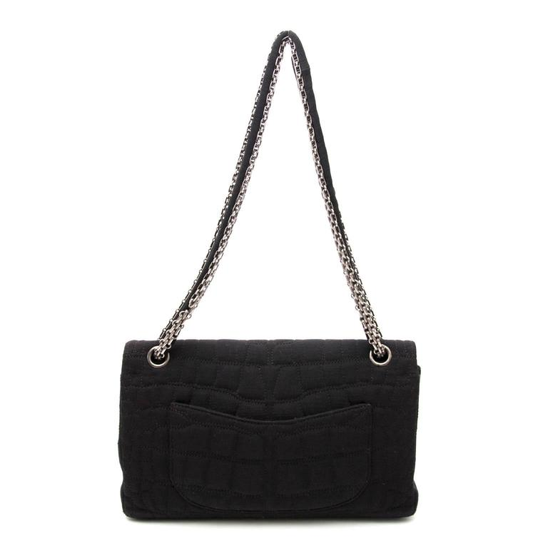 Chanel Large 2.55 Black Fabric Bag  The iconic Chanel 2.55 in a beautiful black fabric. The bag has one large compartiment where you can fit allyour belongings.The inside is finished with the classic burgundy lining and has one pocket. The Chanel