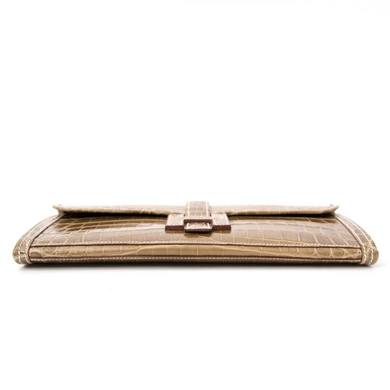 Women's or Men's Hermes Pochette Jige Elan 29 Crocodile Niloticus Lisse Ficelle For Sale