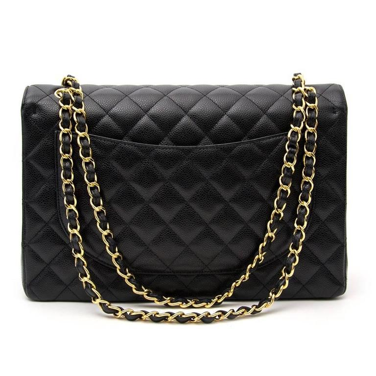 Chanel Black Maxi Caviar Classic Double Flap Bag  4