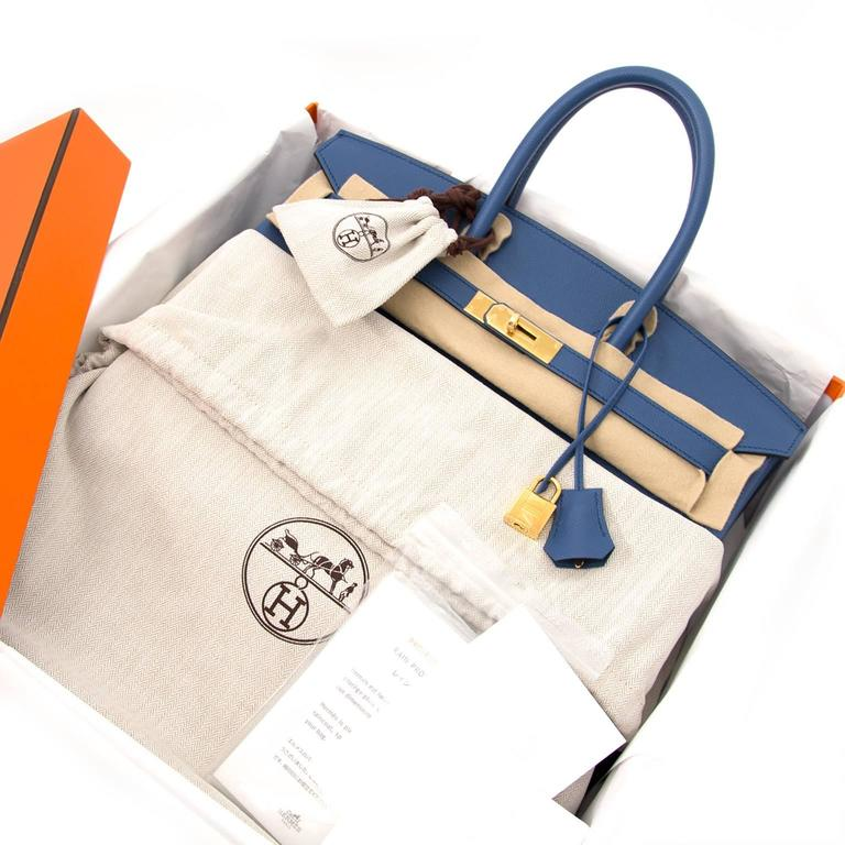 Brand new Hermes Birkin 30 Bleu Agate Epsom GHW The gold-tone hardware emphasizes the timeless and classic bleu agate Epsom leather body. This compressed type of leather holds true to its shape in all instances and is completely resilient to