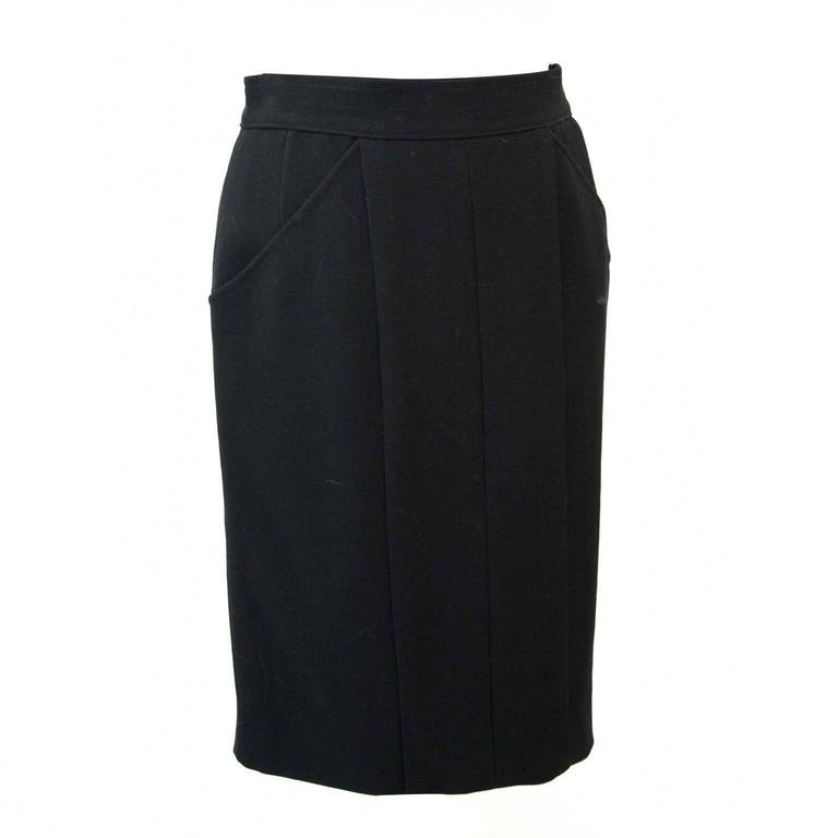 Very good condition  Chanel Black Woolen Skirt - Size: 38  This classic piece of