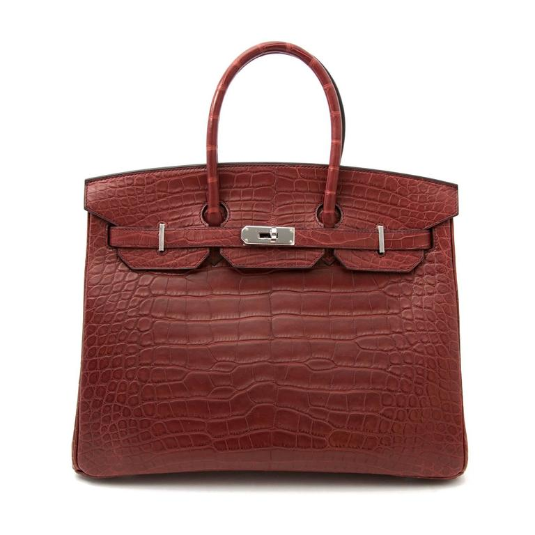 The height of luxury in the form of a bag! Skip the waiting list and get your hands on this extremely rare exotic piece. This gorgeous Hermes Birkin is crafted out of alligator mississippiensis and has a matte finish. The exquisite Bourgogne color