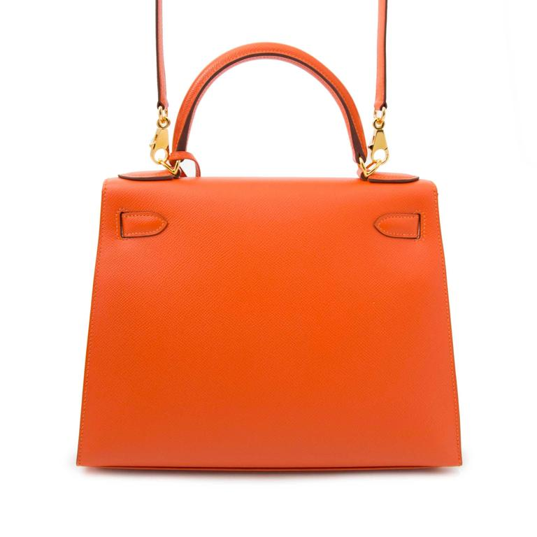 Hermes Kelly Sellier 28 Epsom Feu  Only worn once or twice Iconic Hermès Kelly 28 Epsom. This compressed type of epsom leather holds true to its shape in all instances and is completely resilient to scratches. This vibrant feu color, together with