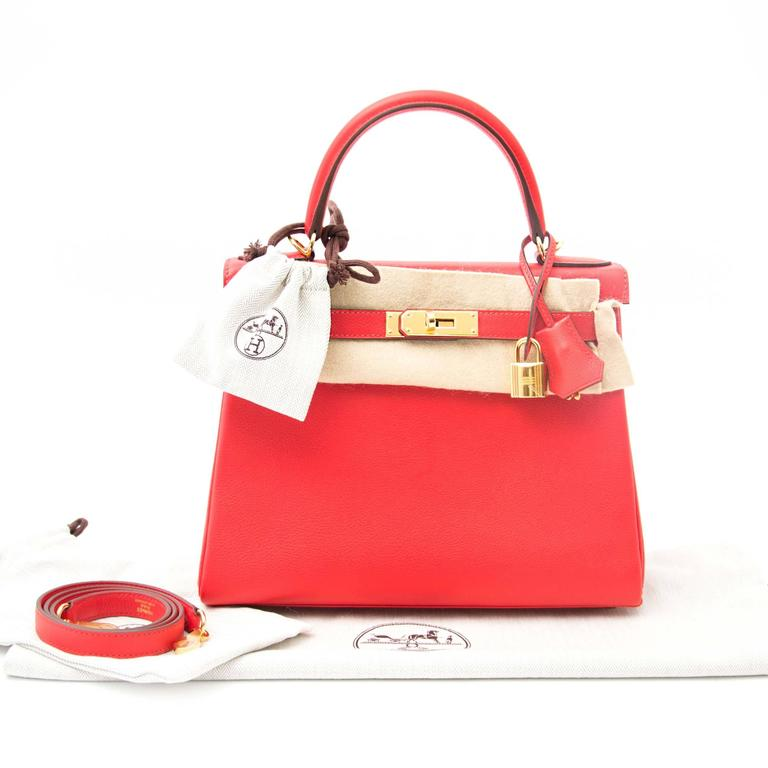Never Used  Hermes Kelly 28 Red Capuccine Evercolor  In the most beautiful special red capucine. Adding a colourful splash to the palette, this capucine is an alternative to the classic colors.  This Hermes Kelly is a real statement piece. This bag