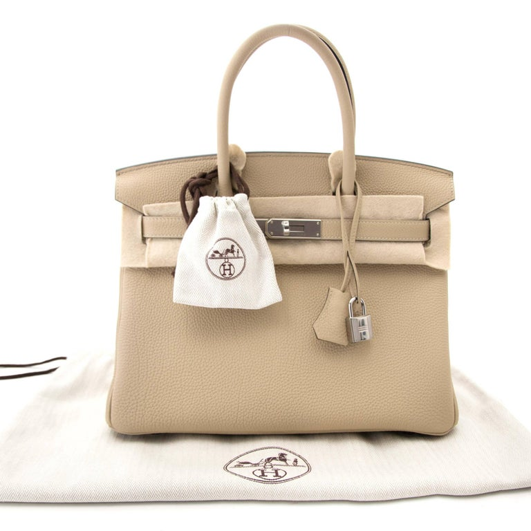 Never used  Never Used Hermès Birkin 30 Togo Trench PHW  This Hermès Birkin 30 comes in a light beige color named Trench, a sophisticated yet chique neutral tone which matches every outfit.  Togo is a grainy and scratch resistant type of leather.