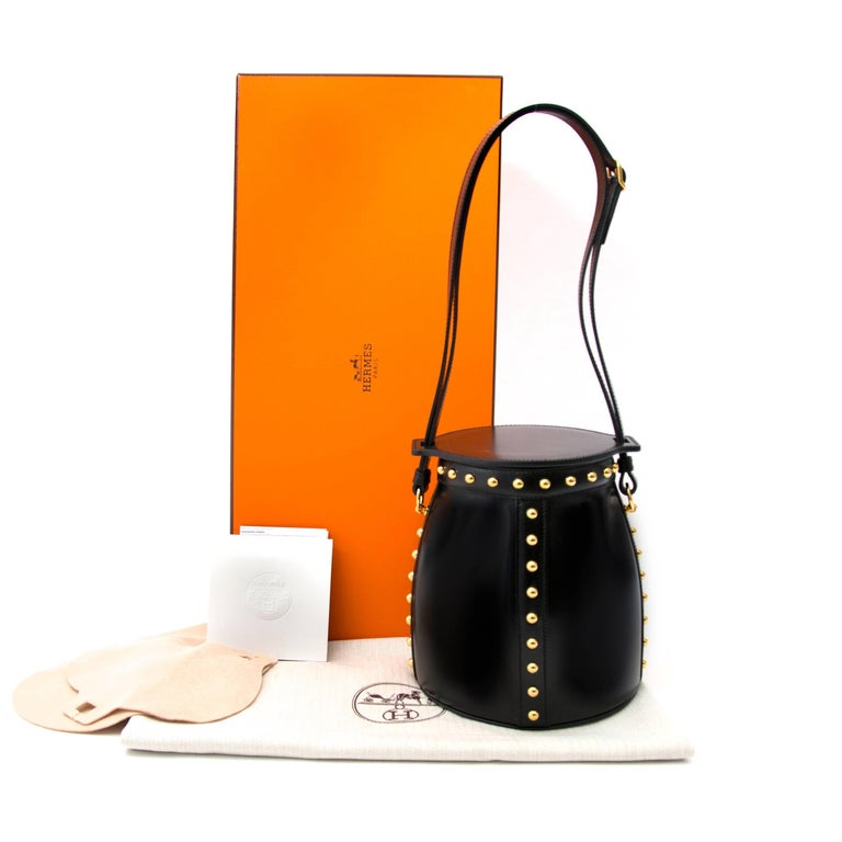 Never worn, sotre fresh  Hermès Farming Clouté Bag Box Calf Black  This Hermès Farming bag comes in black box calf leather featuring gold toned hardware. This piece a true eyecatcher with its golden studs and special design. The interior is made out
