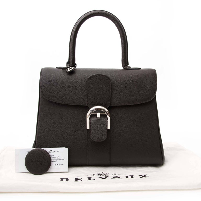 Delvaux Cafe Veau Diamond Brillant   The iconic Delvaux Brillant MM + strap was designed in 1958 and is still very much on trend today. This Delvaux Brillant comes in a medium size and is crafted out of grained diamond leather. The silver toned